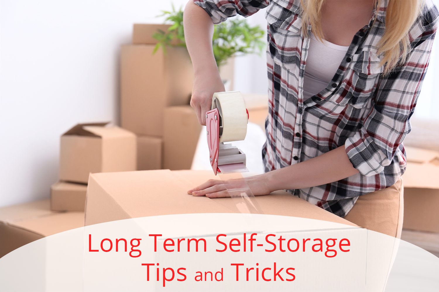 Post Falls woman using our self-storage tips and tricks to pack things away in cardboard box.