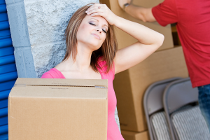 A woman getting stressed because her self-storage unit is too full.
