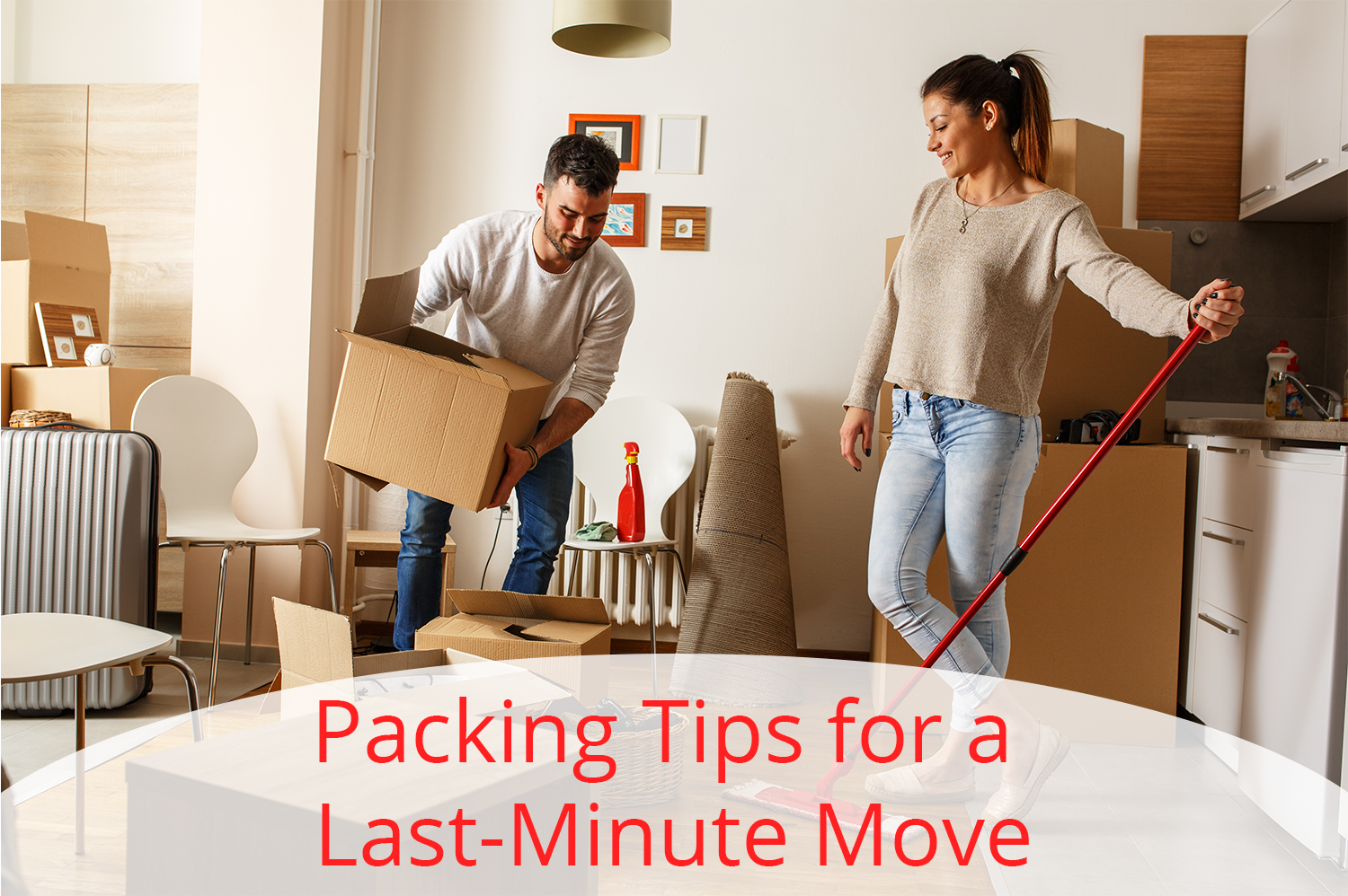 Man and woman packing up their home for a last minute move.